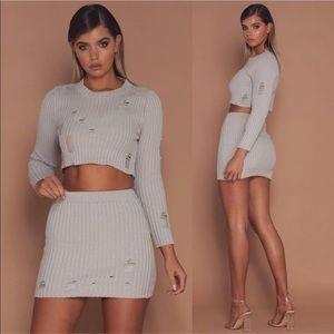 NEW! Meshki Lena distressed ribbed mini skirt 💎